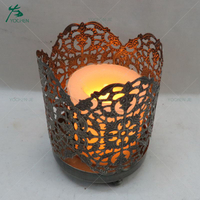 Ornate single metal candle holder for home decoration