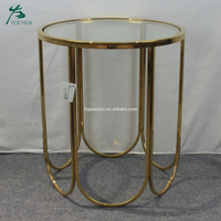 shining golden frame glass round table